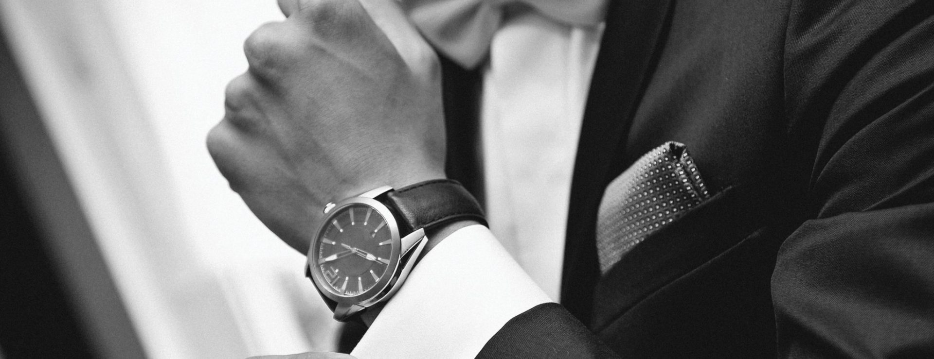 Man-with-suit-and-watch-on-hand