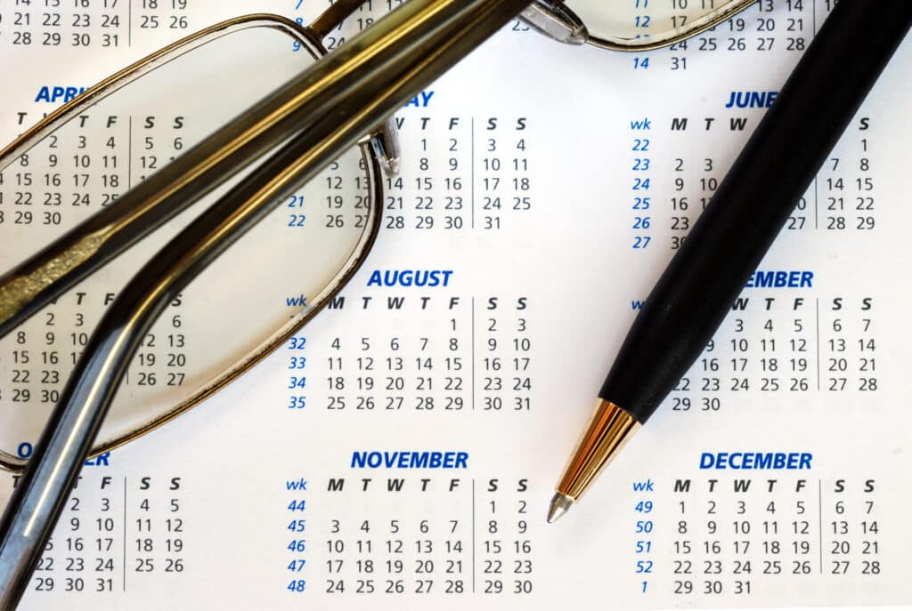 the-modern-gentleman-check-out-the-dates-in-a-business-calendar-concepts-of-planning-ahead